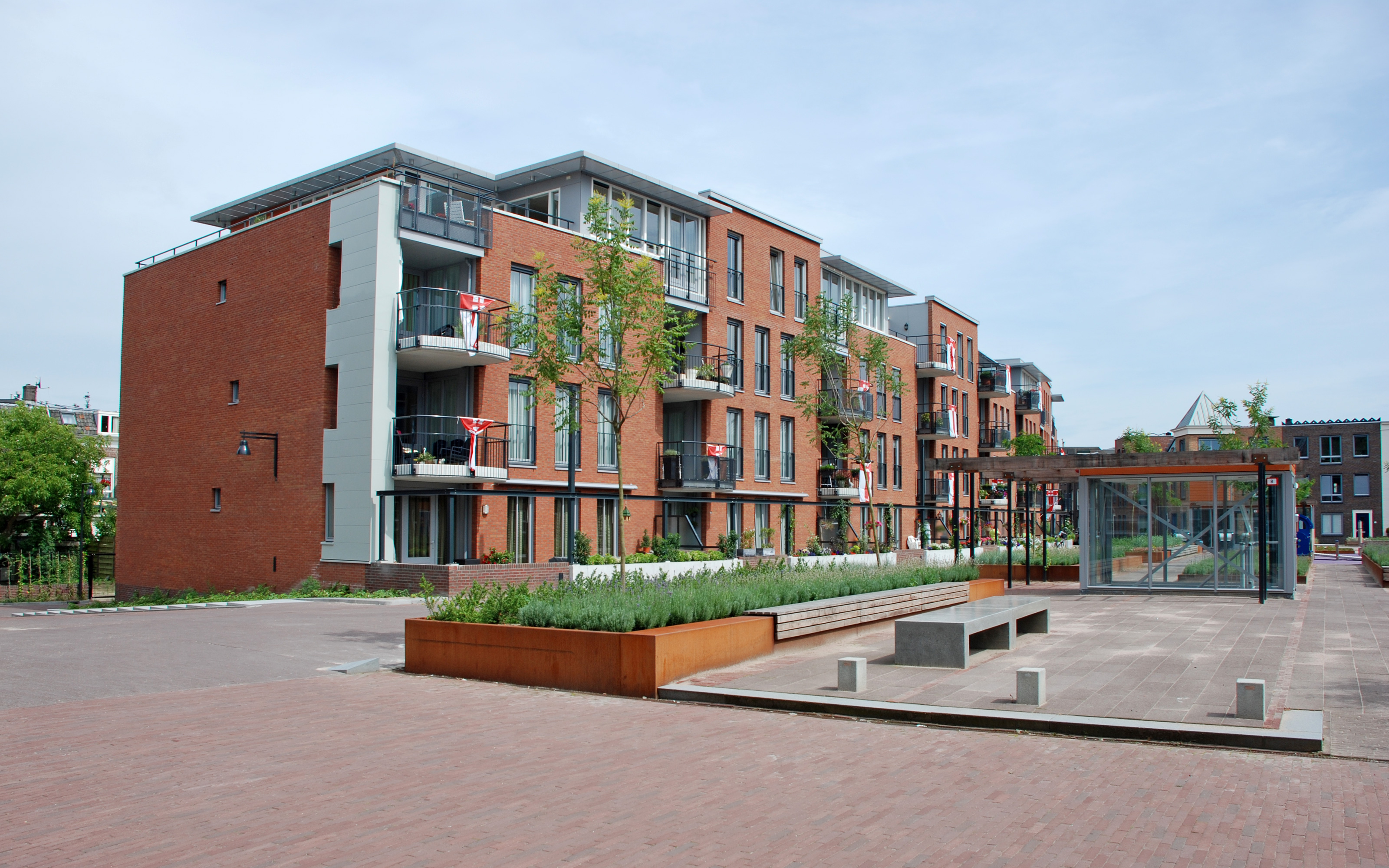 Residential brick buildings with vegetated courtyard