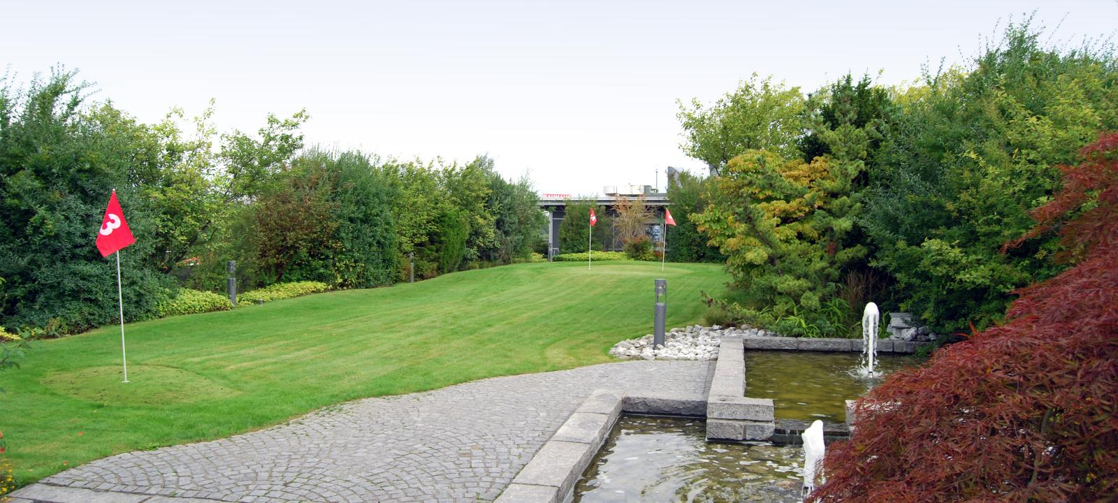 Roof garden with golf course and water basin