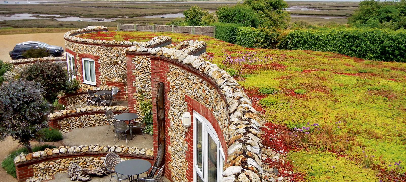 Natural stone buildings with Sedum roof