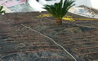 Irrigation driplines on a pitched roof